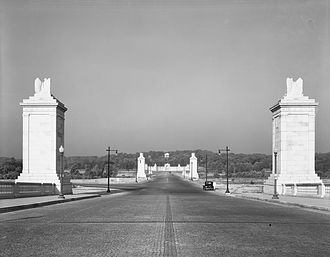 Columbia Island (District of Columbia) - Northern end of Columbia Island shortly after its completion in 1932. The only roads visible are the connecting central axis road to the George Washington Memorial Parkway (left) and the Boundary Channel Bridge (showing completed and incomplete pylons) to Memorial Drive and Arlington National Cemetery in the distance.