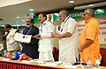 M. Venkaiah Naidu releasing a Coffee Table Book and the Minister of Finance and Coir, Government of Kerala, Shri. T.M. Thomas Isaac, received the first copy.jpg