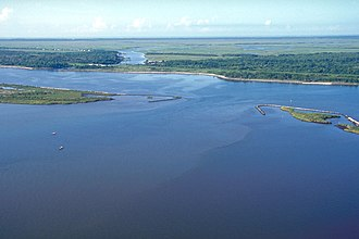 Mississippi River–Gulf Outlet Canal - The MRGO and an outlet into Lake Borgne, approximately 50 miles (80 km) up the canal from its mouth and 15 miles (24 km) east of New Orleans