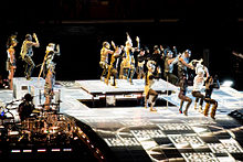Madonna dancing in costume, with many other dancers