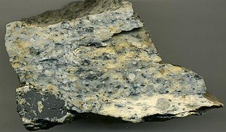 Carbonatite - Magnesiocarbonatite,  from Verity-Paradise Carbonatite Complex of British Columbia. Specimen is 75 mm wide.