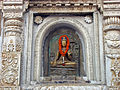 Mahabodhi temple, Buddha image outside.jpg