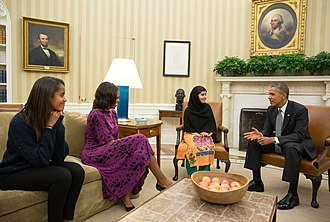 Malala Yousafzai - Barack Obama, Michelle Obama and their daughter Malia meet Yousafzai in the Oval Office, 11 October 2013