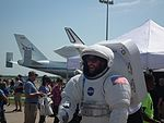 Man In Space Suit In Front Of Space Shuttle Endeavour.JPG