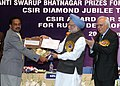 Manmohan Singh giving away the Shanti Swarup Bhatnagar Prize for Science and Technology 2007 to Dr. A. Ajayaghosh of Thiruvananthapuram for his outstanding contribution in Chemical Sciences, in New Delhi on December 20, 2008.jpg