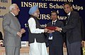 Manmohan Singh presented PURSE Award to Delhi University at the launching ceremony of the INSPIRE- Innovation of Science Pursuit for Inspired Research, a scholarship programme of the Department of Science & Technology.jpg