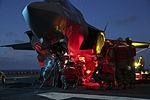 Marines conduct night ordnance load on F-35B at sea 150521-M-GX379-104.jpg