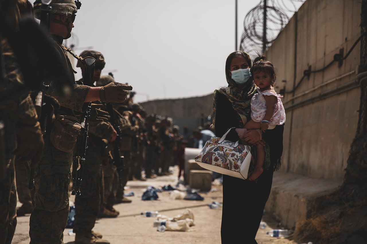 Marines with the 24th Expeditionary Unit (MEU) guide an evacuee during an evacuation at Hamid Karzai International Airport 8 of 8.jpg