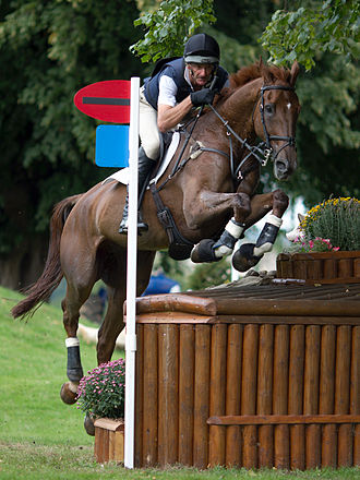 Mark Todd (equestrian) - Todd and Major Milestone at the Dairy Farm during the cross-country phase of Burghley Horse Trials 2010