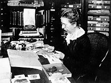 Mary Jane Rathbun working with crab specimens.