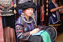 220px-Miao_woman_in_Yangshuo_%28China%29.jpg