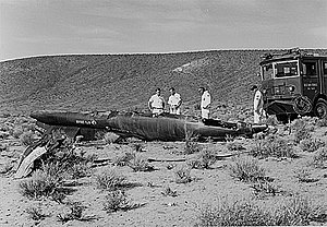 Michael J. Adams - Firefighters survey the wreckage of Adams' X-15