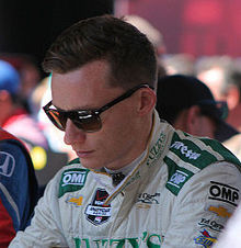 Driver Mike Conway, in uniform and dark glasses