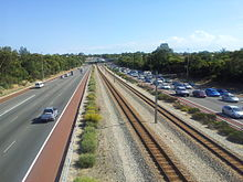 Photograph of freeway and railway
