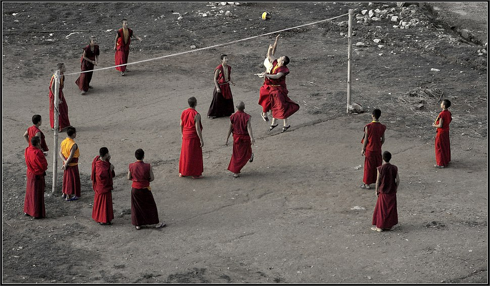 Monks play volleyball in Sikkim India