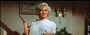Monroe holding hammer in The Seven Year Itch trailer 2.jpg