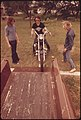 Motorcyclist from Leakey, Texas, Loads His Cycle on a Truck with the Help of Friends near San Antonio, 05-1973 (3704383462).jpg