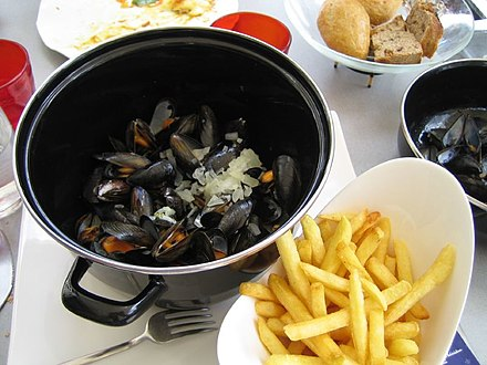 Moules-frites or mosselen met friet is a representative dish of Belgium. Moules Frites.jpg
