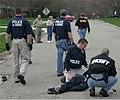 Multi-agency team w fugitive.jpg