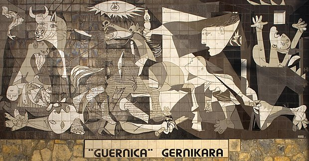 Mural in Guernica based on the Picasso painting. Basque nationalists advocate that the painting be brought to the town, as can be seen in the slogan underneath. Mural del Gernika.jpg