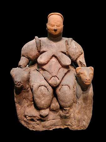 Statuette of a nude, corpulent, seated woman flanked by two felines from Catalhoyuk, dating to c. 6000 BCE, thought by most archaeologists to represent a goddess of some kind Museum of Anatolian Civilizations 1320259 nevit.jpg