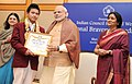 Narendra Modi presenting the National Bravery Awards 2015 to the children, in New Delhi on January 24, 2016. The Union Minister for Women and Child Development, Smt. Maneka Sanjay Gandhi is also seen (3).jpg