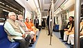 Narendra Modi taking a ride in Metro from Botanical Garden Station to Okhla Bird Sanctuary along with the Governor of Uttar Pradesh, Shri Ram Naik and the Chief Minister, Uttar Pradesh (1).jpg
