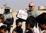 National Guardsmen distribute school supplies DVIDS342624.jpg
