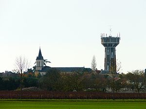 Neuville-de-Poitou - The church and the water tower