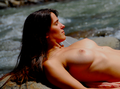 Nude on rocks at riverfront.png