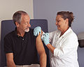 Nurse administers a vaccine (1).jpg
