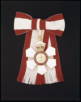Orders, decorations, and medals of Canada - The insignia for a female Officer of the Order of Canada