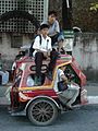 Overloaded tricycle in the Philippines with students.jpg