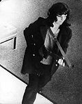 Patty Hearst during a bank robbery