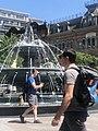 People walk by Dog Fountain, Toronto.jpg