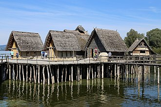 Stilt house - Reconstruction of Bronze Age German stilt houses on Lake Constance, Pfahlbaumuseum Unteruhldingen, Germany.