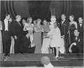 Photograph of First Lady Bess Truman and Margaret Truman cutting the cake at the Roosevelt Birthday Ball, as Margaret... - NARA - 199253.tif