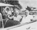 Photograph of President Truman and Governor Jesus Pinero of Puerto Rico in their automobile as their motorcade... - NARA - 200465.tif