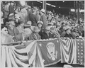 Photograph of President Truman and other officials in the stands at Griffith Stadium in Washington, for the opening... - NARA - 199576.tif
