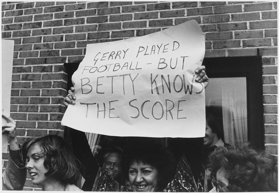 Photograph of a Woman Holding a Sign in Portland Maine, Supporting First Lady Betty Ford For Her Stance on Various... - NARA - 186817.tif