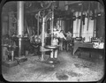 Photograph of four San Francisco Mint employees in the Machine Shop. - NARA - 296569.tif