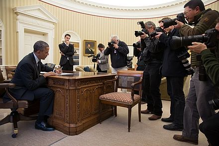 Photojournalists photographing President Barack Obama of the US in November 2013. Photojournalists photograph President Barack Obama.jpg