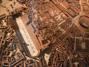 Circus Maximus - Model of Rome in the 4th century AD, by Paul Bigot. The Circus lies between the Aventine (left) and Palatine (right); the oval structure to the far right is the Colosseum.