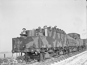 QF 6-pounder 6 cwt Hotchkiss - Polish troops manning an armoured train with a 6-pounder in its original tank mounting at the end, Scotland February 1941
