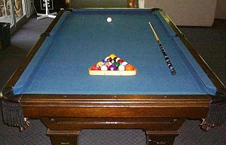 Cue sports - Pool table with equipment.
