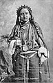 Postcard of portrait of 19 year old Tibetan woman in Lhasa-style dress and amulet.jpg