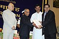 Pranab Mukherjee presenting the Hindi Award, at the Hindi Divas Function, in New Delhi. The Union Home Minister, Shri Sushil Kumar Shinde and the Minister of State for Home Affairs, Shri Jitendra Singh are also seen.jpg