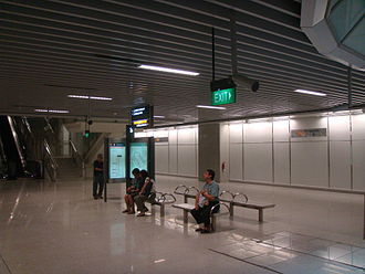 Promenade MRT station - HarbourFront-bound platform level of Promenade MRT station. Notice the unused platform on the right, which was meant to be a cross-platform interchange with the Downtown line and later converted to a transfer link-way to the Downtown Line platforms.