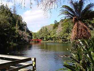 Pukekura Park - The main lake at Pukekura, with Poet's Bridge and Mount Taranaki in the background