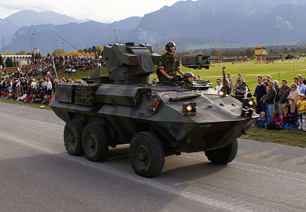 Mowag Piranha-based, TOW-armed ATGM carrier of the Swiss Army Pzj Tow PIRANHA - Schweizer Armee - Steel Parade 2006.jpg